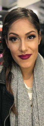 Glitter eye with false lashes, winged liner, and an ombré lip