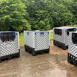Four container boxes outside in a garden