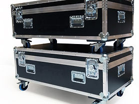 Two flight cases that are stacked up on each other