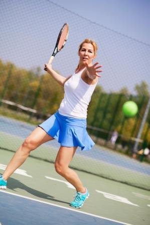 Woman playing tennis in Marin