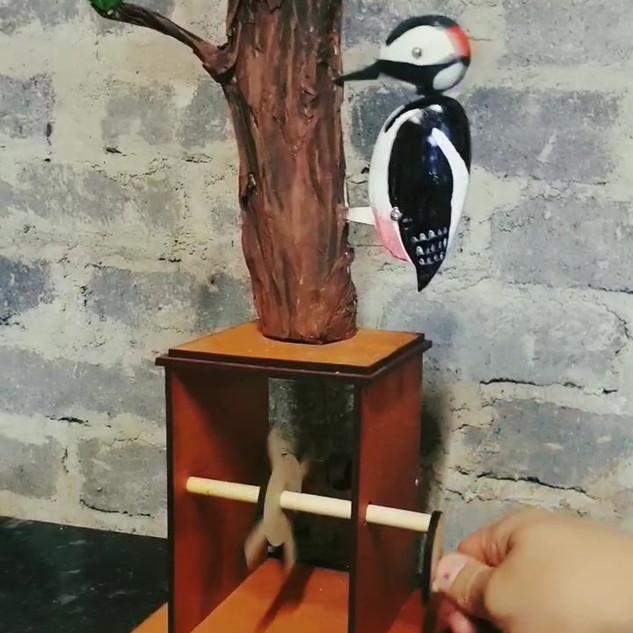 Pecking machine