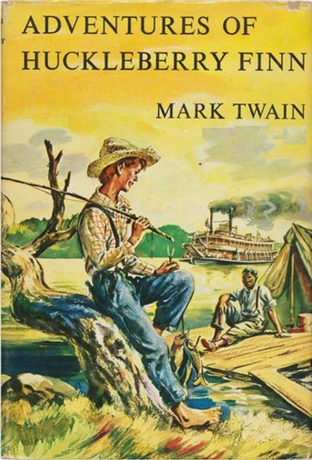 """Book cover of """"Adventures of Huckelberry Finn"""" with an illustration of a youn man leaning against a naked tree by the river."""