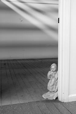 Doll in doorway 1
