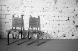 Chairs on wall bw 1