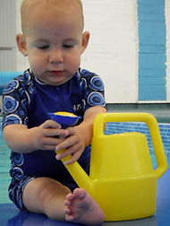 Ryder on mat with watering can 2.jpg