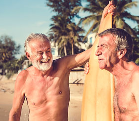 Mature surfers at the beach.jpg
