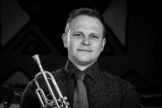 Harvey Hall (trumpeter, pionist, backing vocals and percussionist)