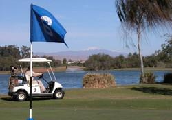 Golf et Atlas à l'arrière-plan