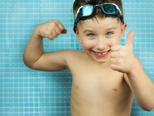 Boy thumbs up pool.jpg