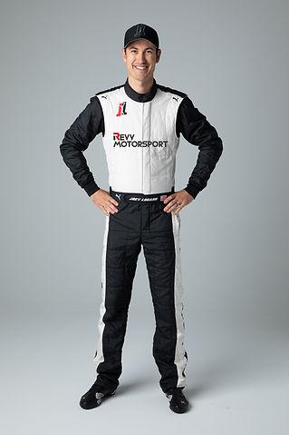 Joey Logano in a REVV-branded driver suit.jpg