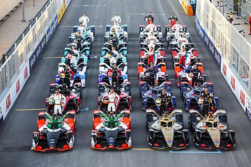 Drivers and race cars on the grid at the