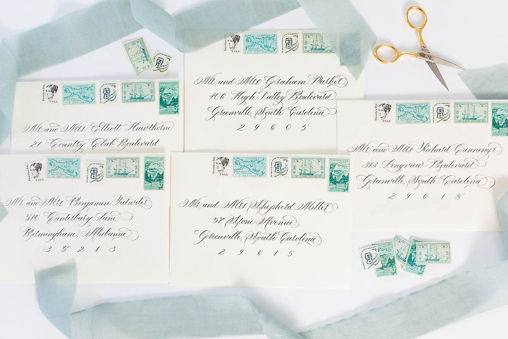 cream and green wedding invitations with calligraphy