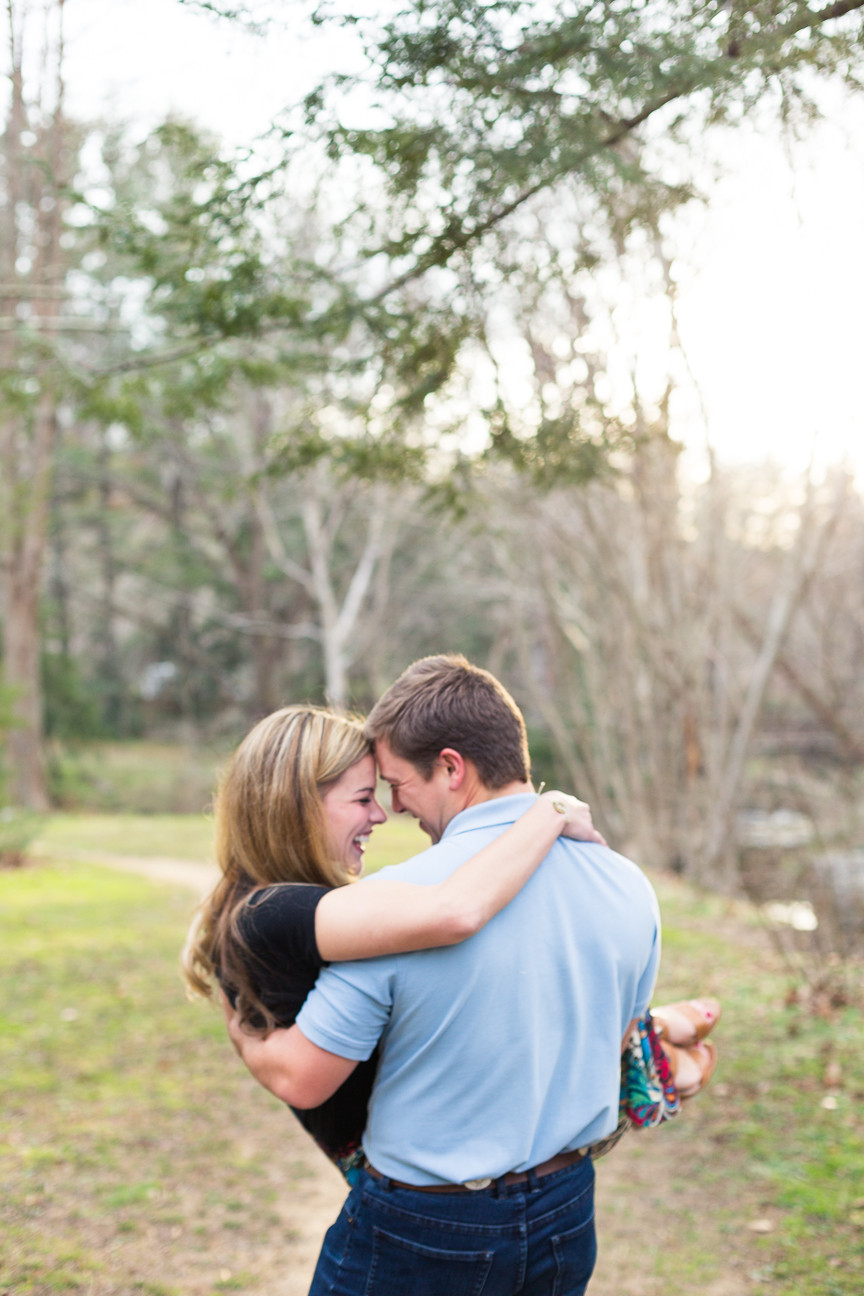 groom carries bride through park, Asheville engagement session