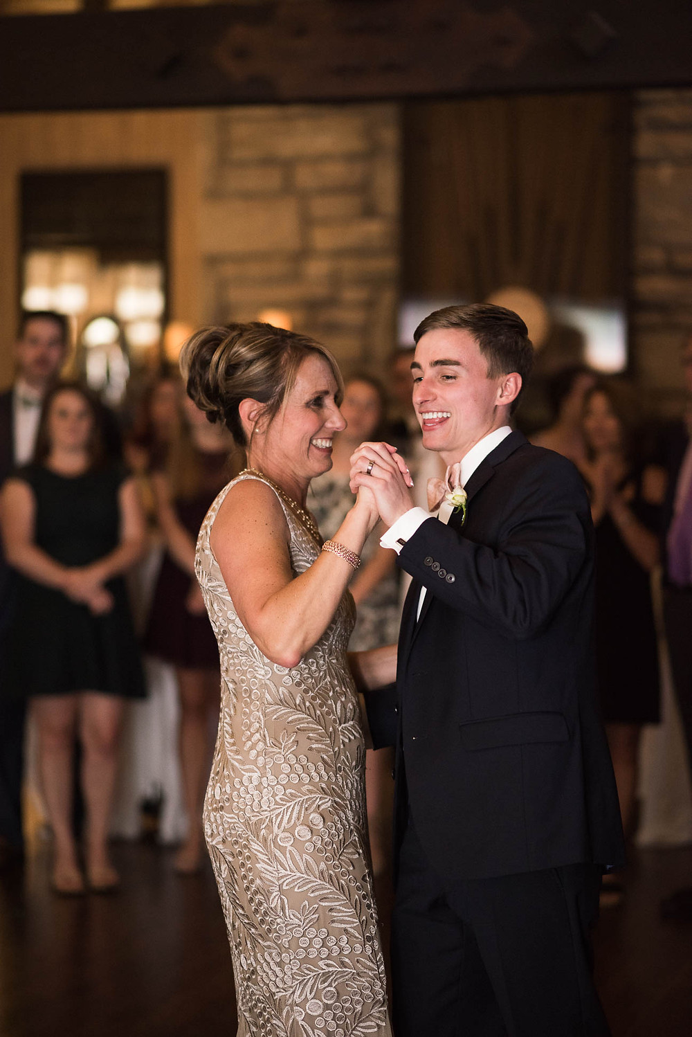 groom dances with his mother at his country club reception