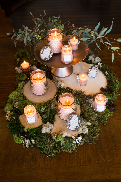 lit-current-rose-candles-on-moss.jpg