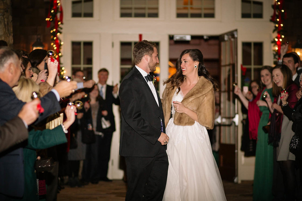 photo of a bride and groom depart their Christmas time wedding in Georgia