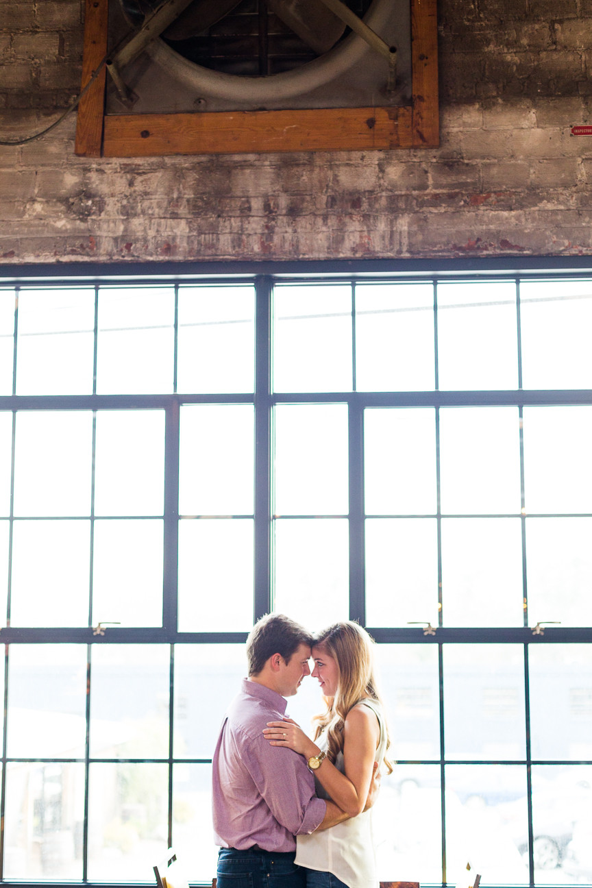couple in front of window, Asheville engagement session