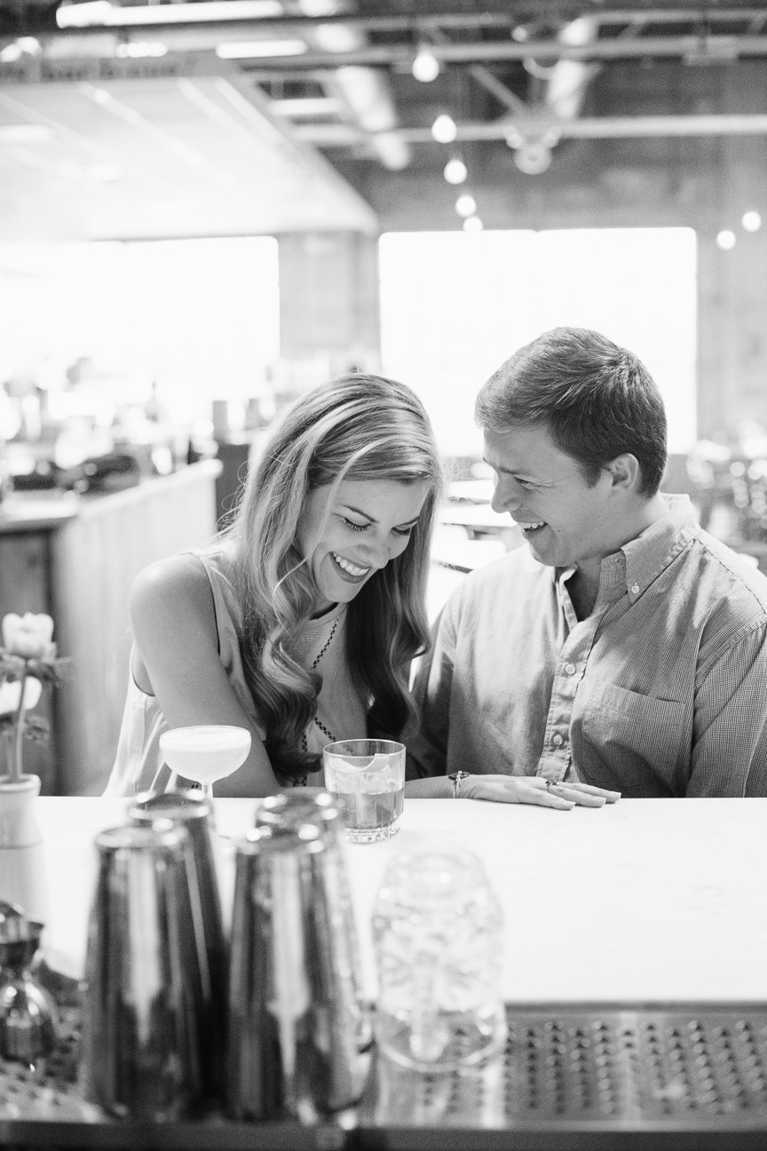 couple laughing at bar, engagement session