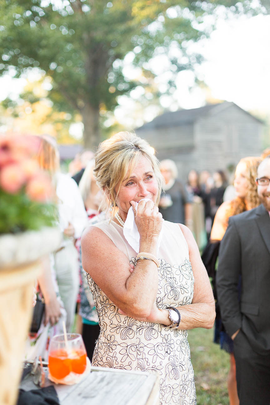mother of bride cries as she watches first dances