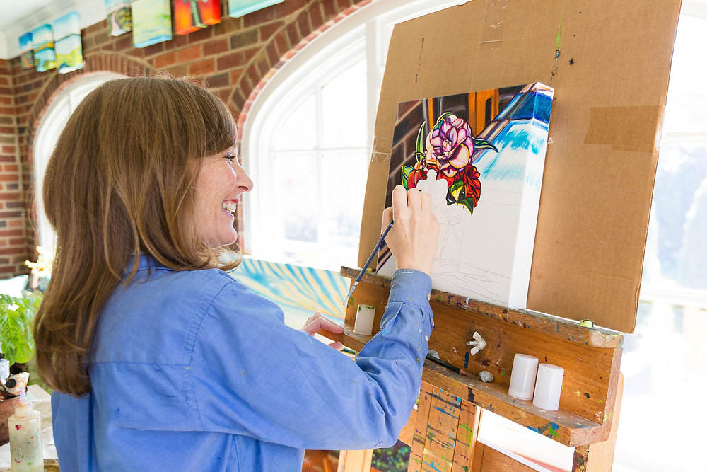 Marie Scott painting flowers in studio, Greenville SC artist