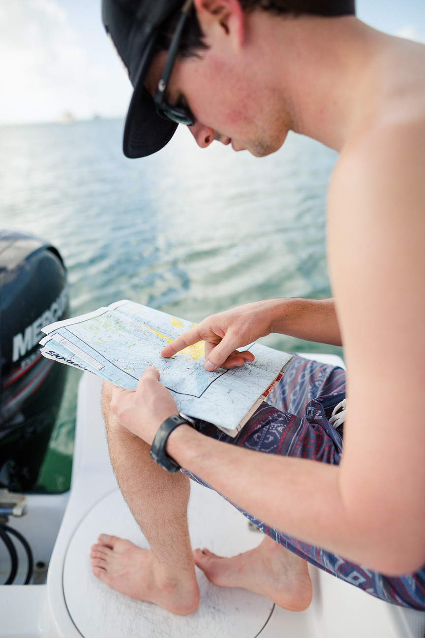 Ned looking at map on boat in Key West, FL