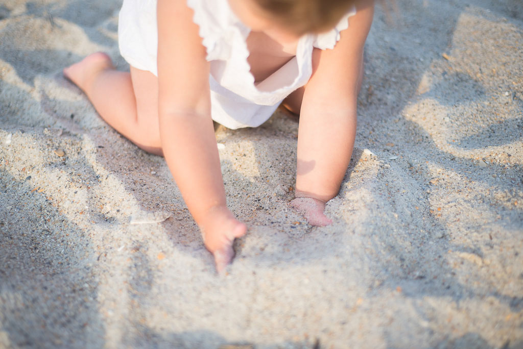 Little Girl Plays in Sand Image