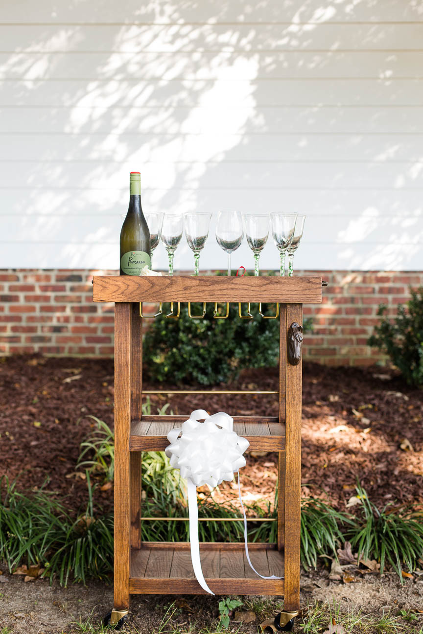 hand made bar cart with wine glasses and horse bottle opener