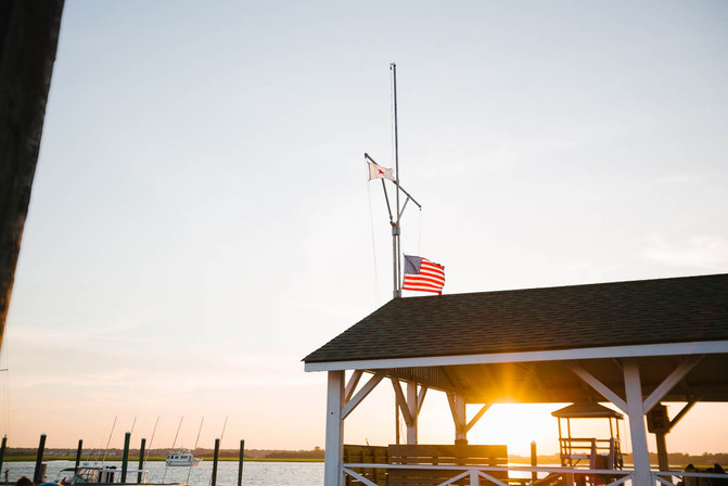 American-flag-flies-over-dock-in-Wrights