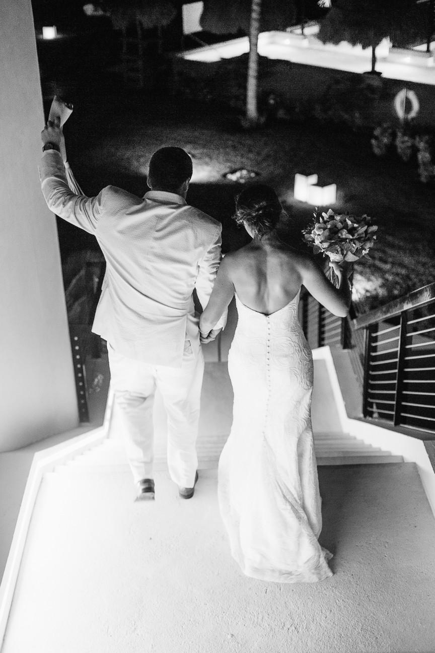 image of bride and groom walking away