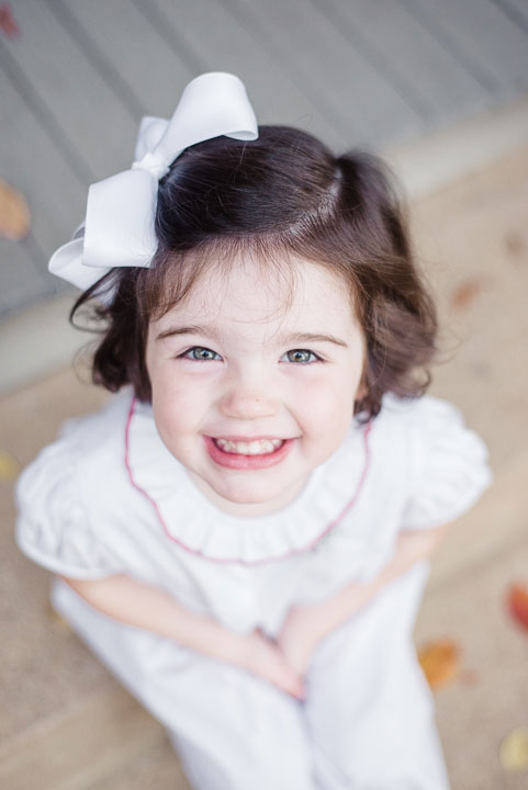 Smiling Little Girl on Porch Image