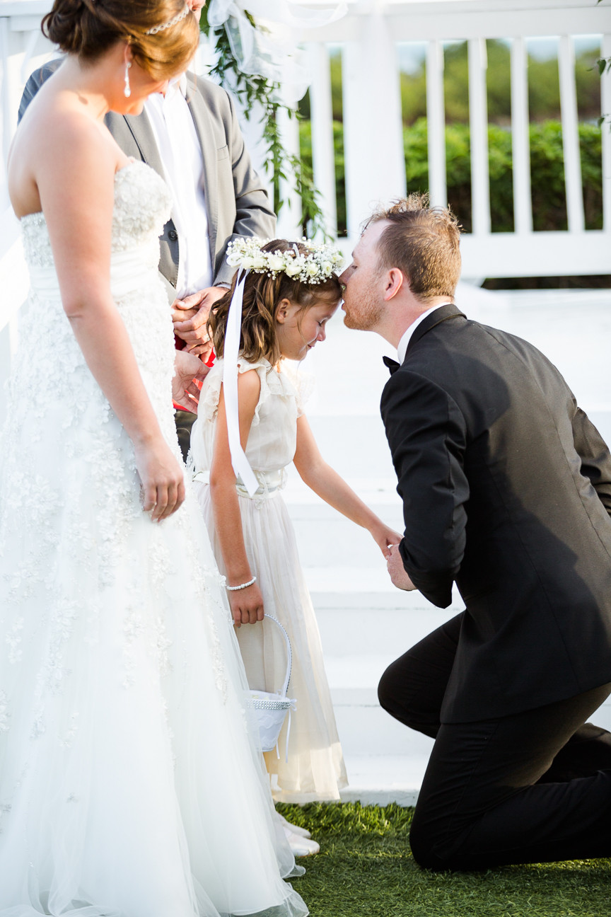 Groom kisses step-daughter during wedding ceremony, flower girl, destination wedding, southern weddings, wedding photography