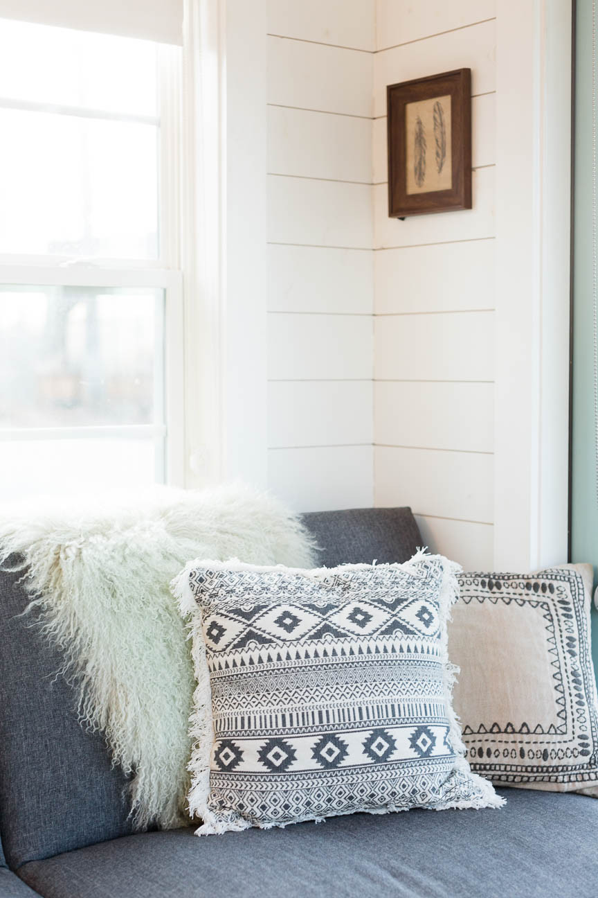 couch and pillows in tiny home