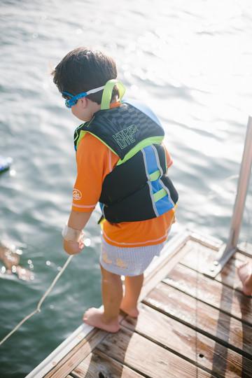 Little-boy-jumps-off-dock