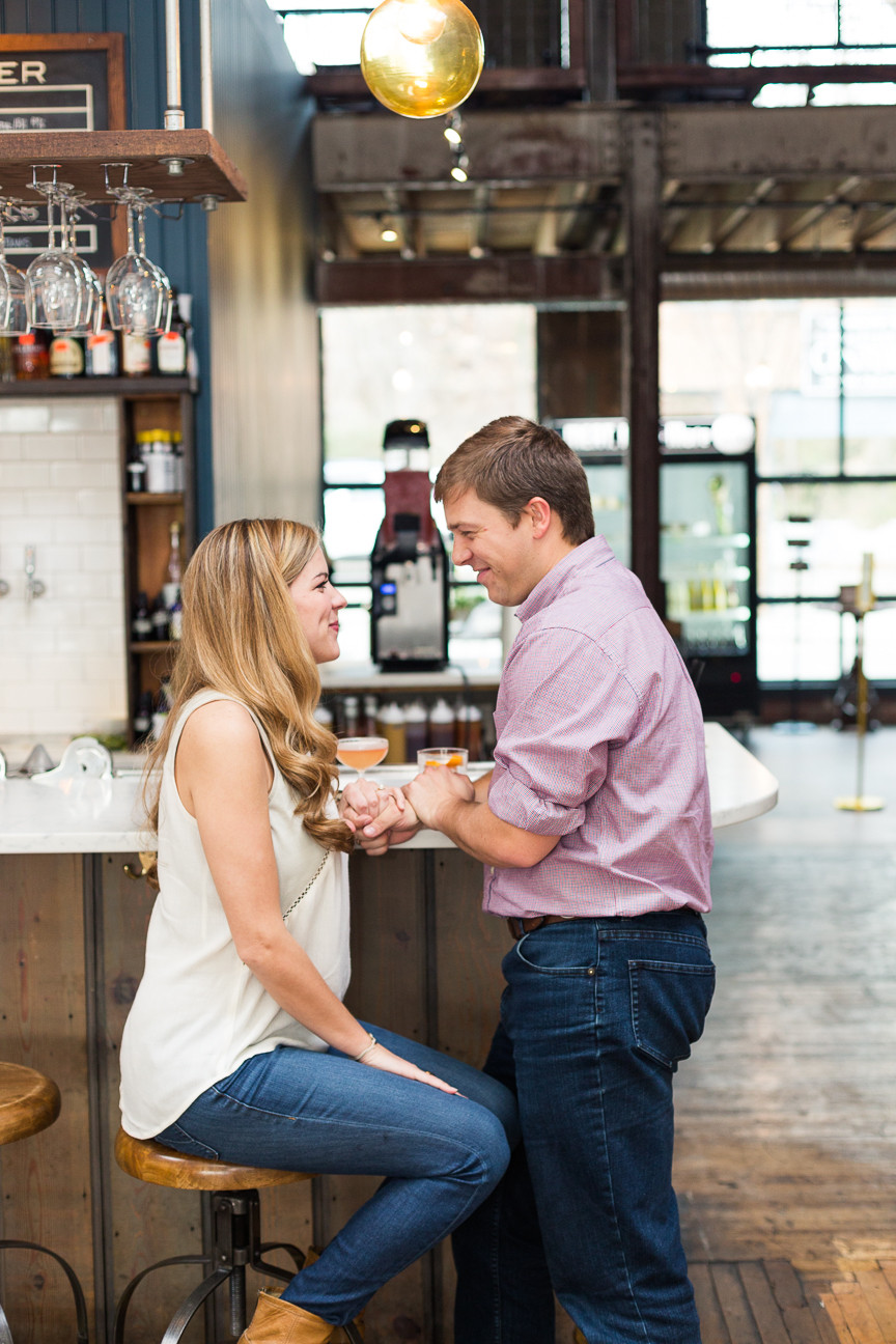 couple standing at bar, engagement session