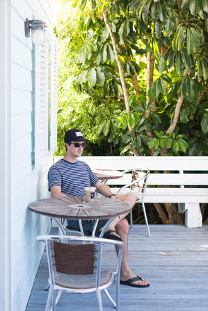 traveler-enjoys-coffee-at-on-porch-in-El