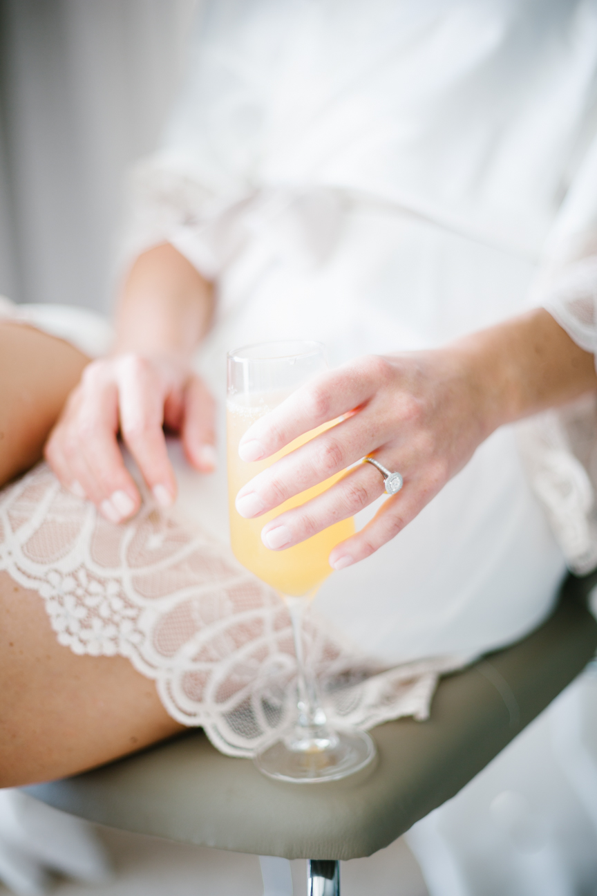 Bride holds mimosa