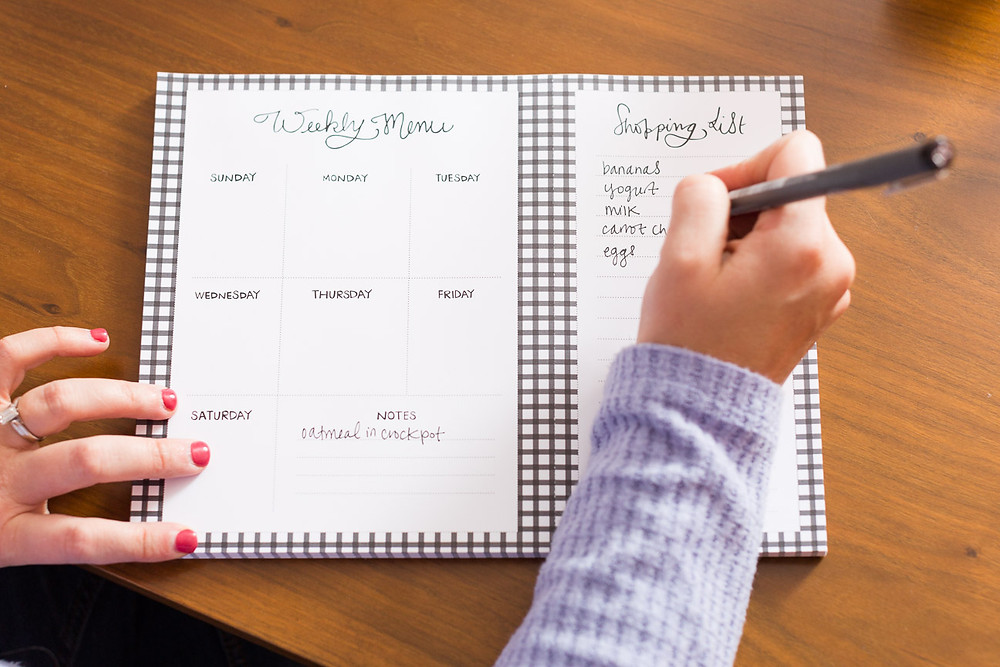 image of handing writing on weekly meal planner