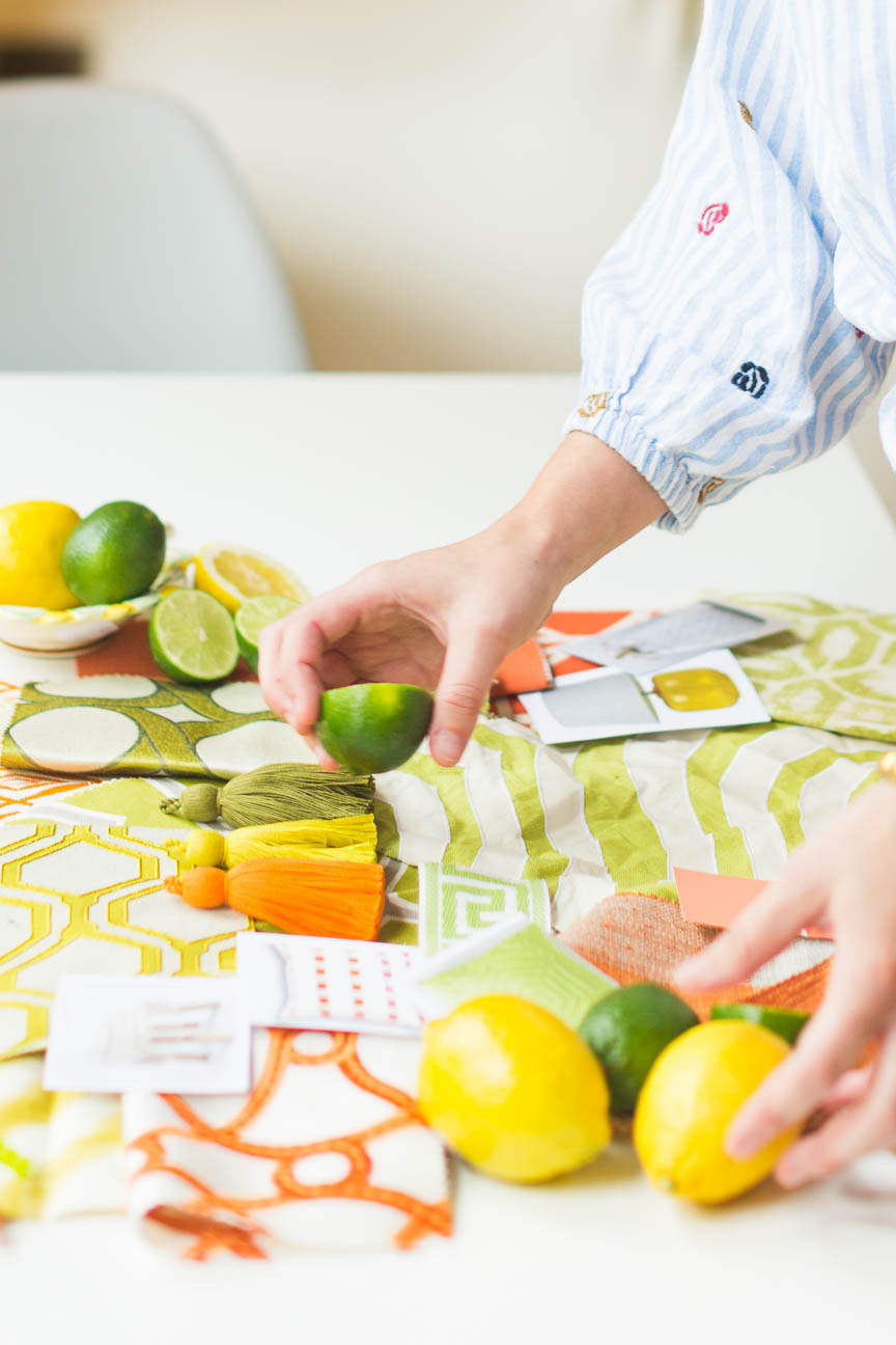 image of an interior designer placing limes for a styled photo