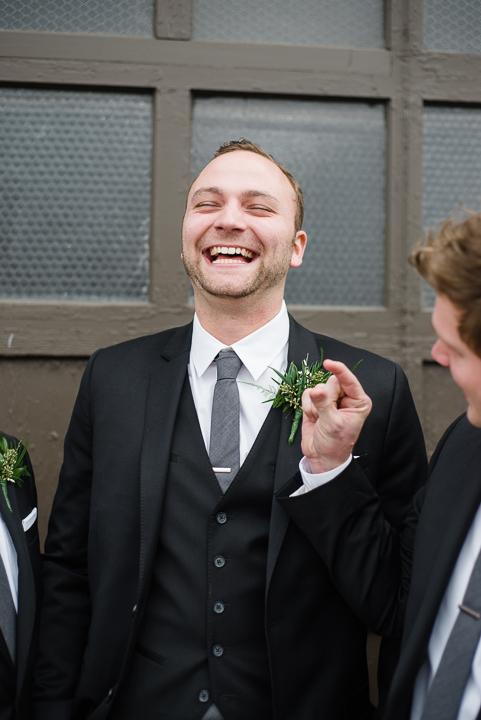 Groom laughs with Groomsmen Image