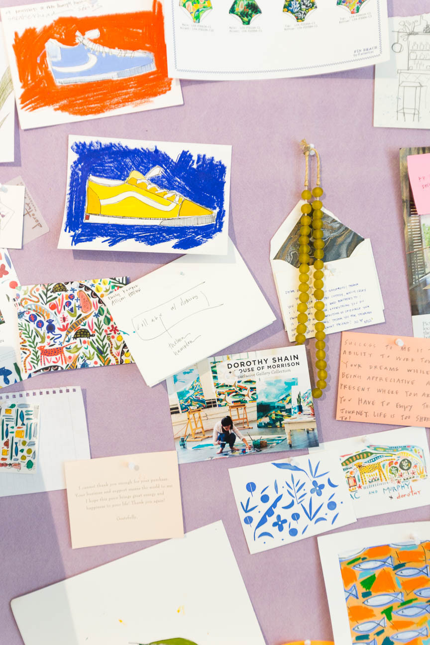 image of inspiration board with art in artist studio