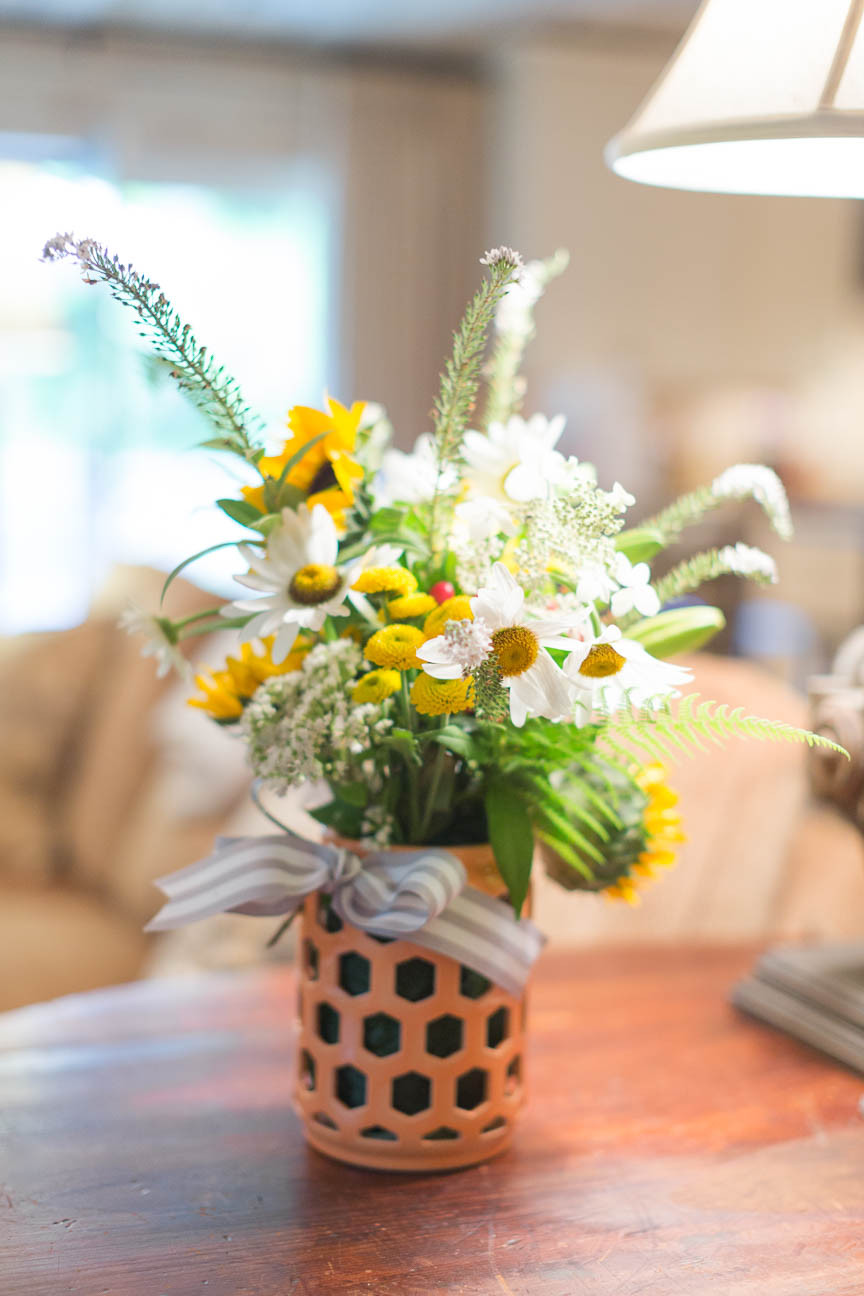 image of flowers in coral vase