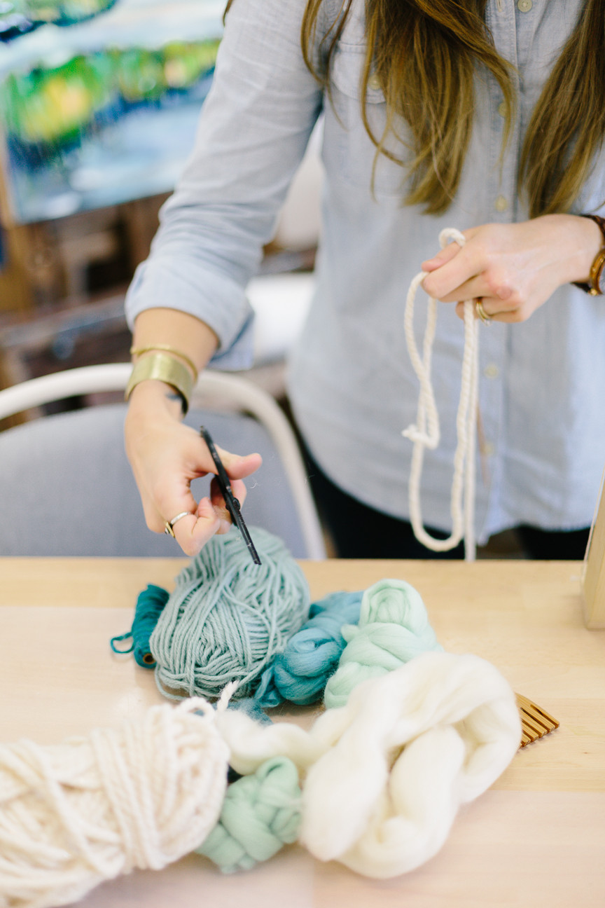 Meredith Piper cuts yarn for weaving, Greenville SC Artist