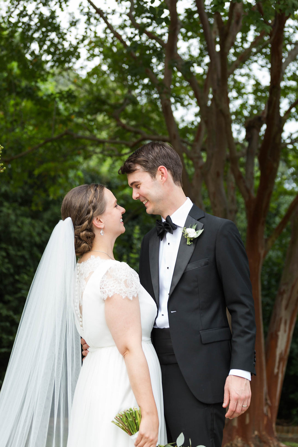 portrait of newlyweds smiling at each other