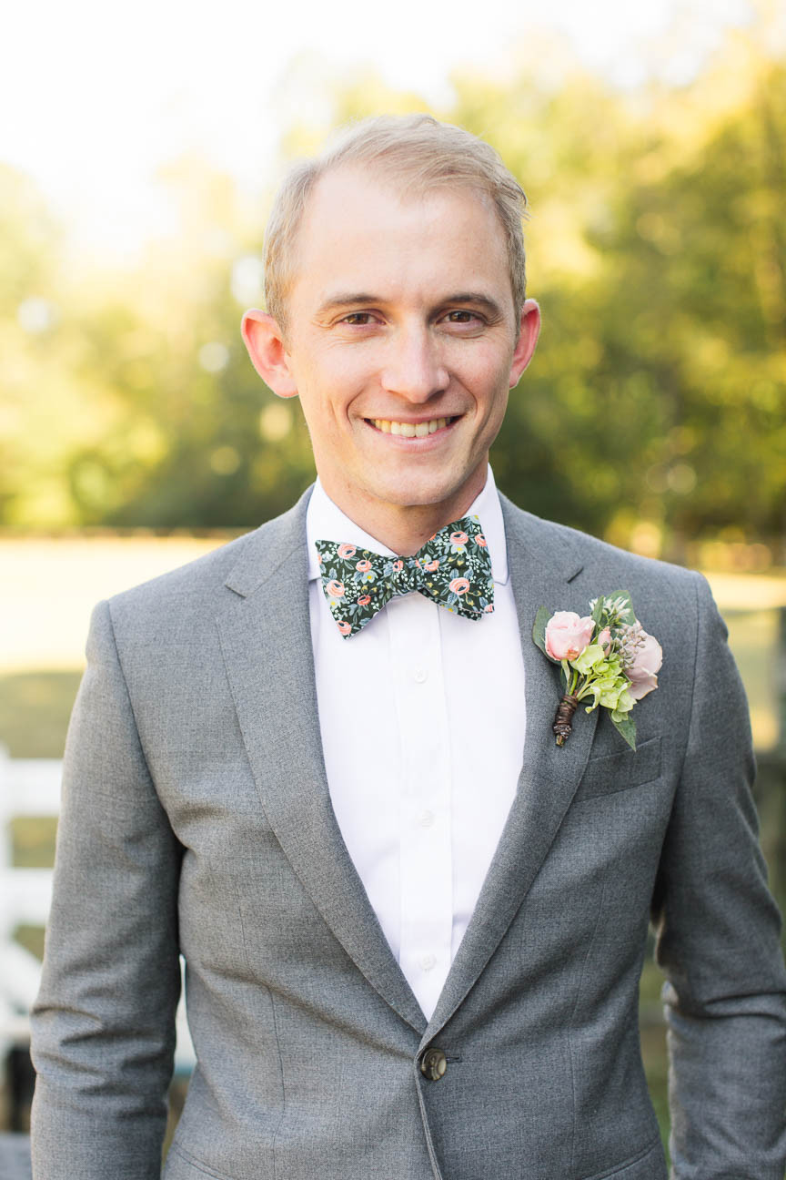 portrait of groom smiling on his wedding day