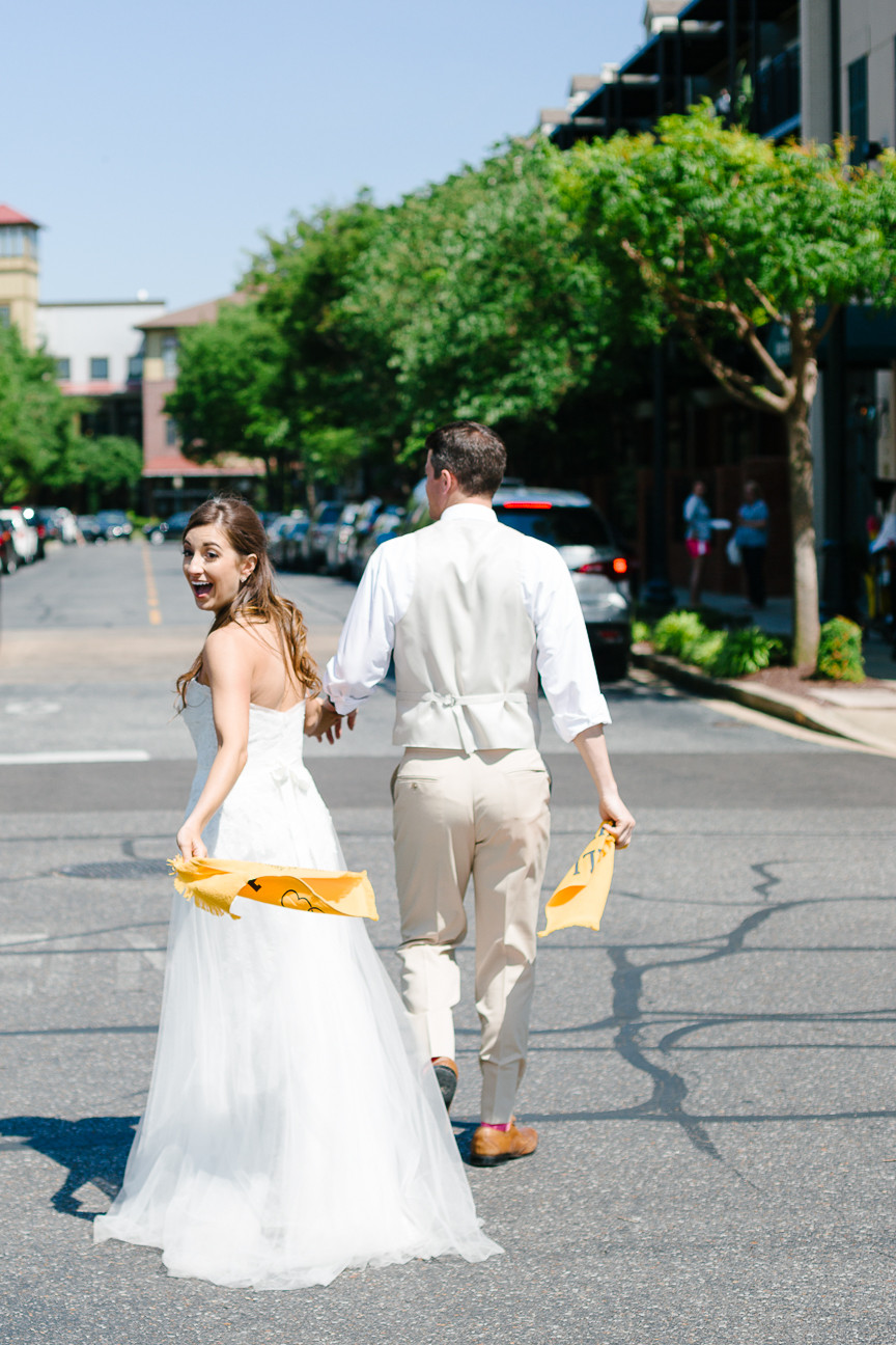 image of bride and groom walking through Harbor Town