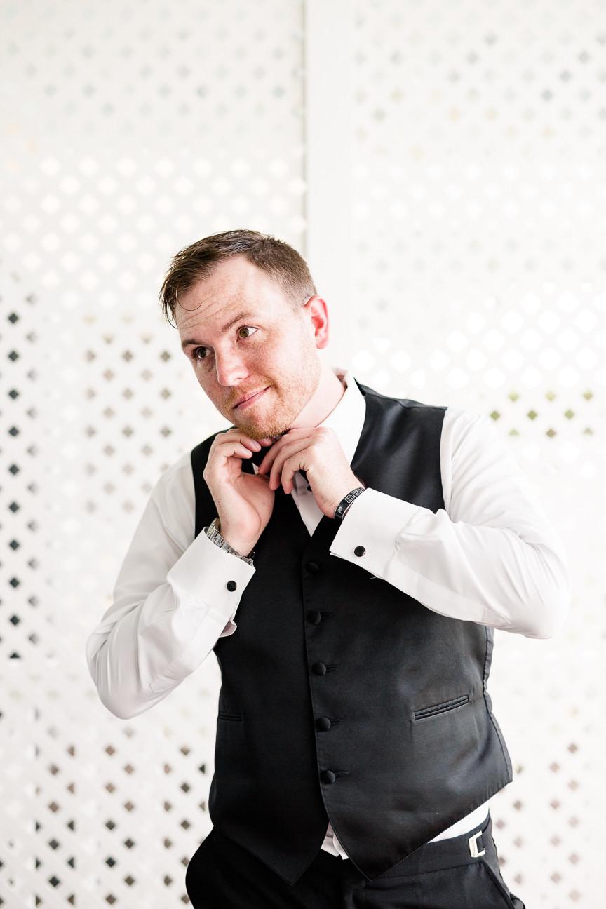Groom ties bowtie, groom prepares for wedding, destination wedding, southern weddings, wedding photography