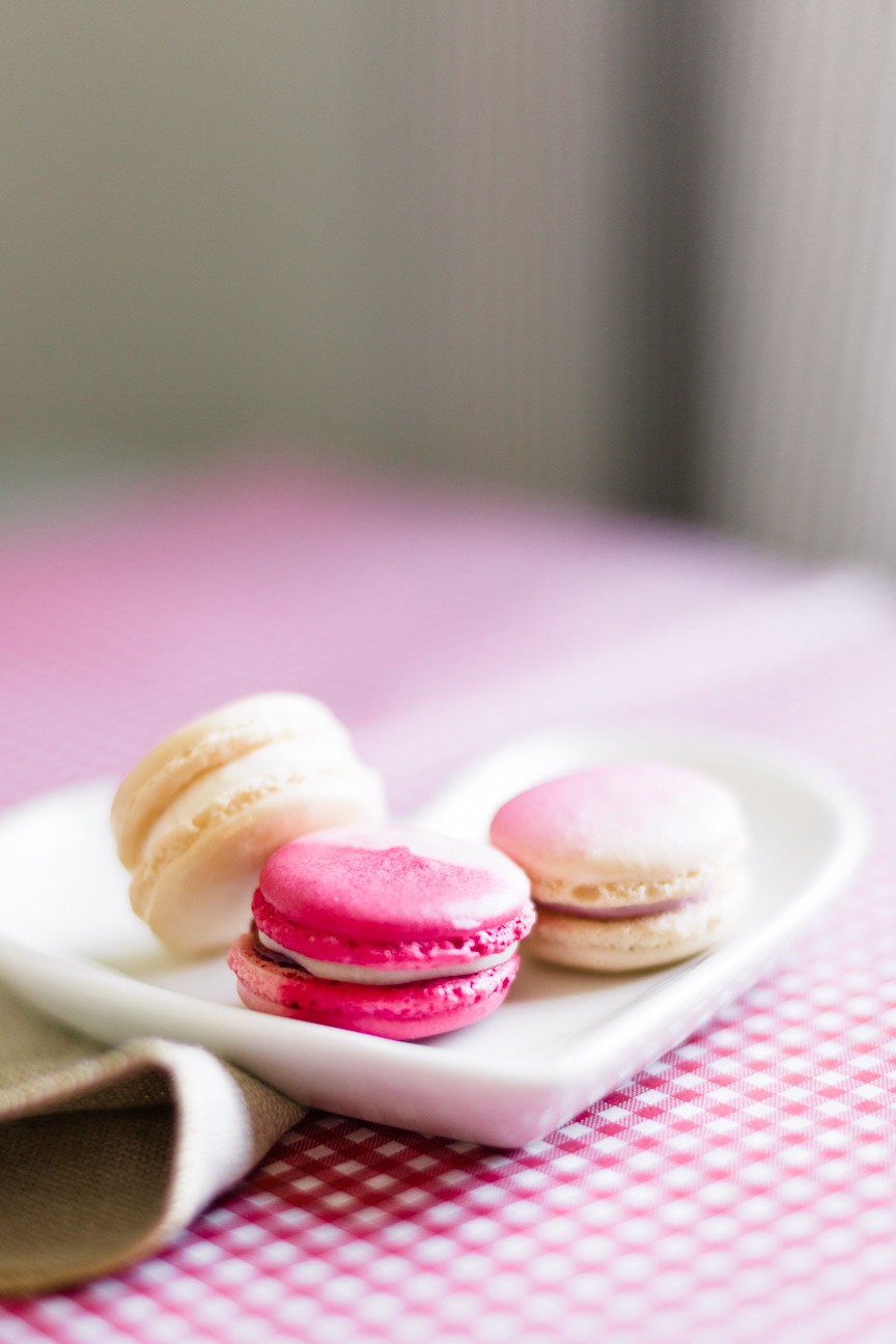 pink macaroons on heart plate for Valentine's Day, food photography, food styling