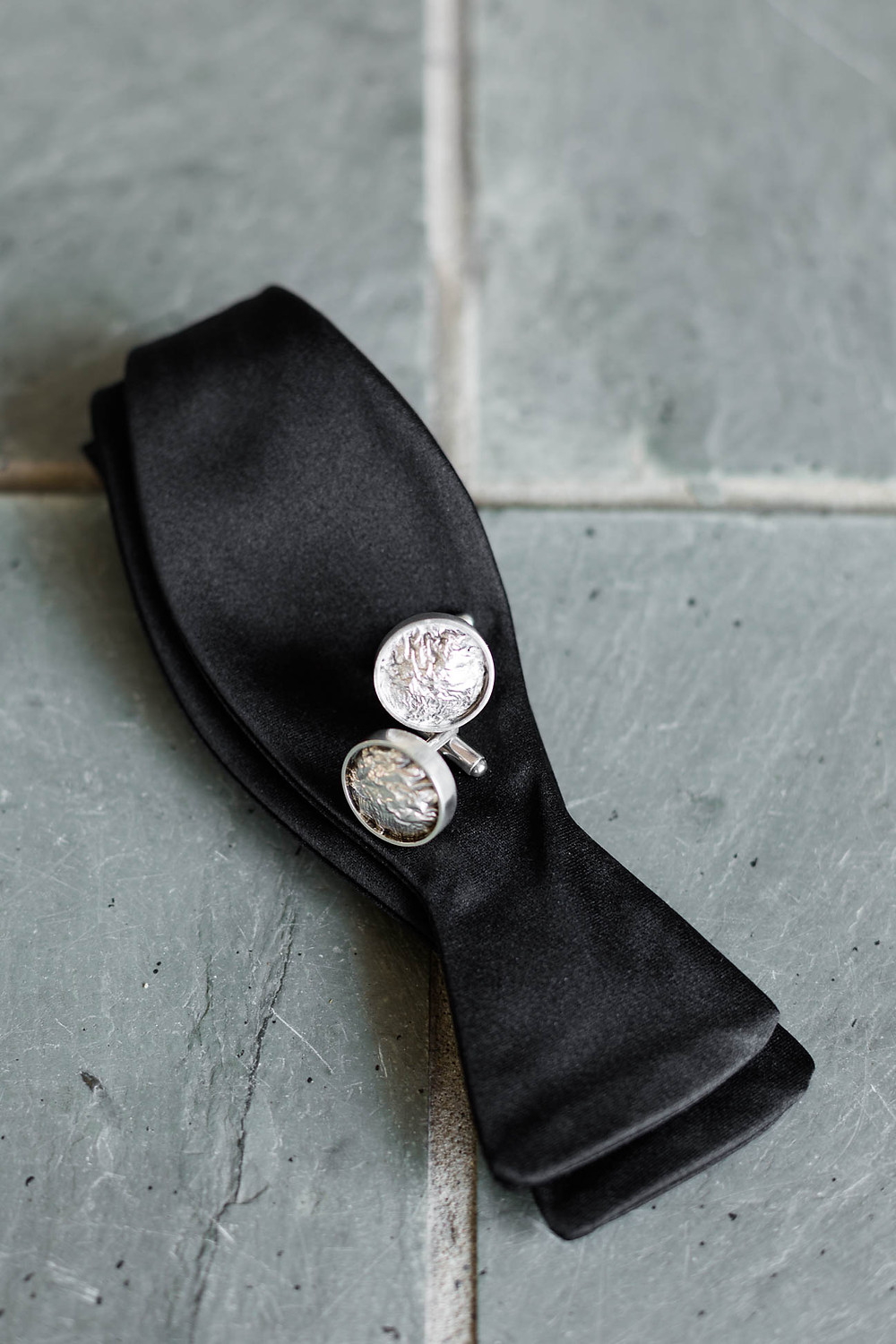 groom's bowtie and cufflinks for his wedding day tuxedo