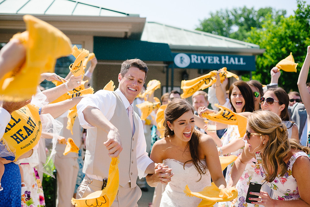 image of guests waving basketball towels to send off the newlyweds