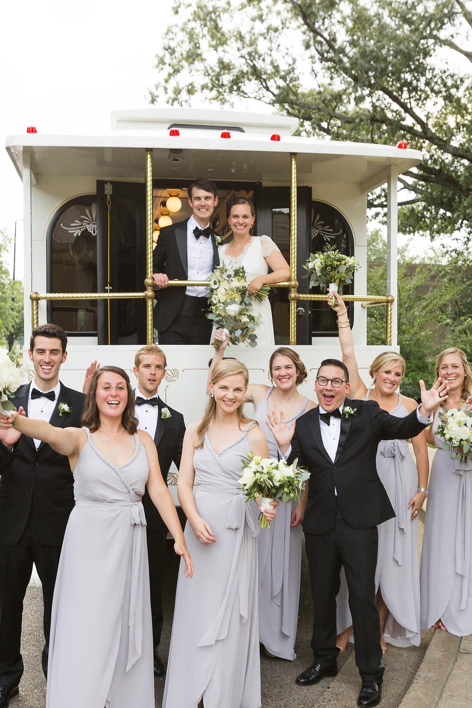 wedding party celebrates the newlyweds